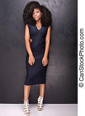 Young african american girl posing in studio.