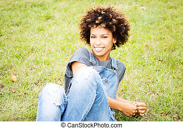 Young african american girl posing outdoor.