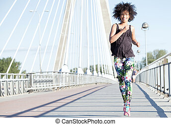 Young african american girl running.