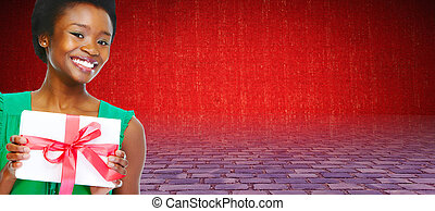 Young African american girl with envelope.