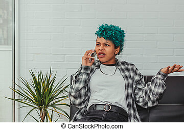 young african american girl with mobile phone at home talking