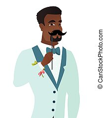 Young african-american groom with a fake mustache. - Young...