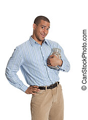 Young African American guy holding jar of money