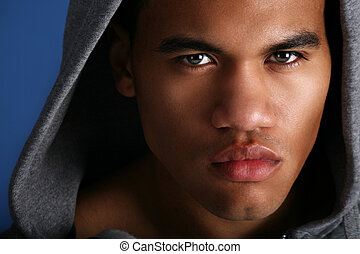 Young African American Male Low Key Portrait on Blue...