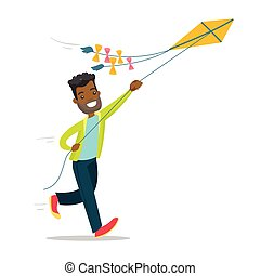 Young african-american man flying a kite.