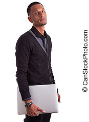 Young african american man holding a laptop