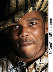 young African American man in hunting hat and shirt - closeup