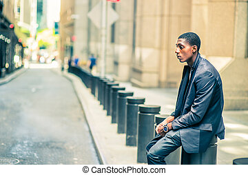 Young African American Man thinking outside on street in New York
