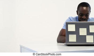african-american man using laptop