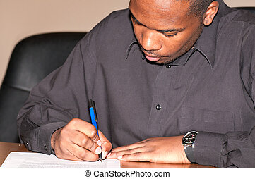 Young african-american man writing