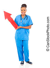 young african american nurse holding arrow sign