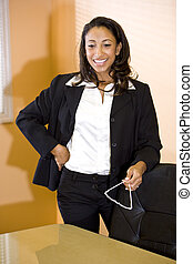 Young African American office worker standing in boardroom