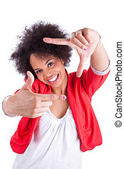 Young african american photographer making frame gesture with the hands, isolated on white background