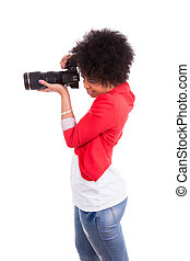 Young african american photographer taking a picture - Black people, isolated on white background