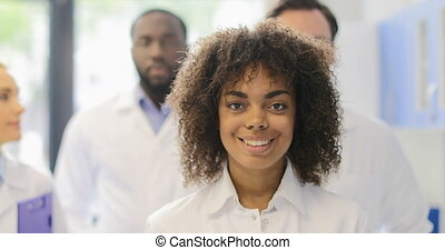 Young African American Scientist Girl With Team Of Researchers In Modern Laboratory Happy Smiling Diverse Men And Women Group