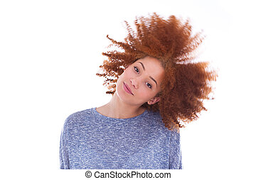 Young african american teenage girl playing with her curly hair isolated on white background
