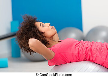 Young African American woman doing Pilates