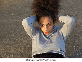 Young african american woman doing sit ups