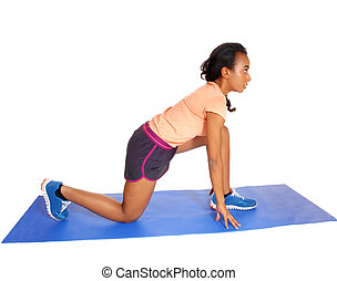 Young African American woman exercising.