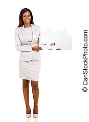young african american woman holding paper house