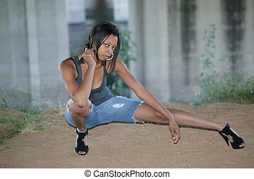 Young African American woman in cutoff jeans
