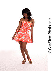 Young African American woman in orange dress