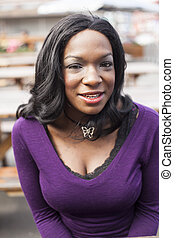 Young African American Woman in Purple Top