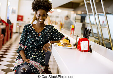 Young african american woman in the diner