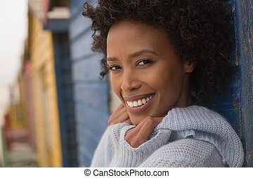 Young African American woman looking and smiling at camera