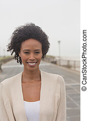 Young African American woman looking at camera on promenade