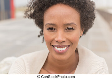 Young African American woman looking at camera