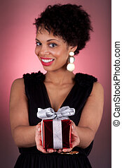 Young African American woman offering a gift