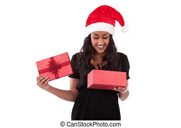 Young African American woman opening a gift box