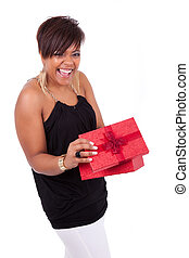 Young African American woman opening a gift