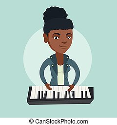 Young african-american woman playing the piano.