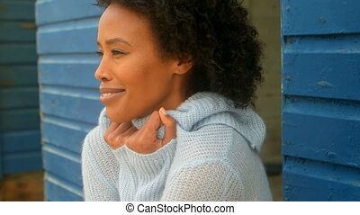 Young African american woman shivering while standing on ...