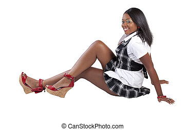 Young African American Woman sitting on floor