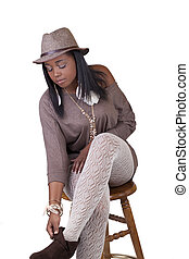 Young African American Woman Sitting Textured Stockings