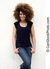 Young african american woman smiling with afro hair