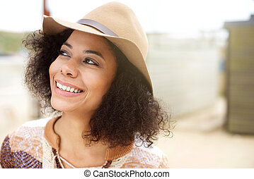 Young african american woman smiling with hat