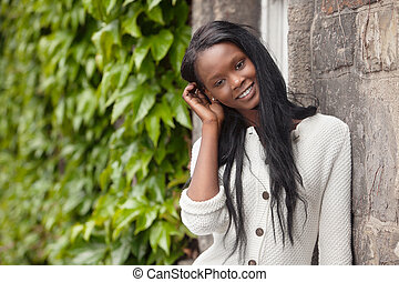 Young African American woman standing and smiling