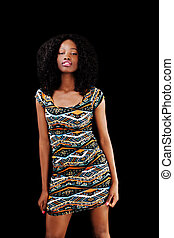 Young African American Woman Standing In Dress Black Background