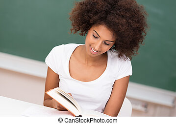 Young African American woman studying