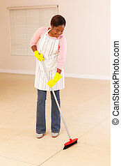 young african american woman sweeping