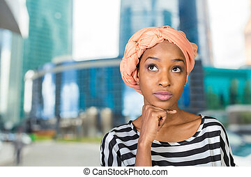 Young African American woman thinking