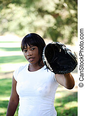 Young African American woman with baseball glove