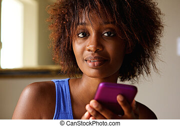 Young african american woman with cell phone