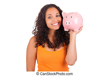 Young african american woman with piggy bank