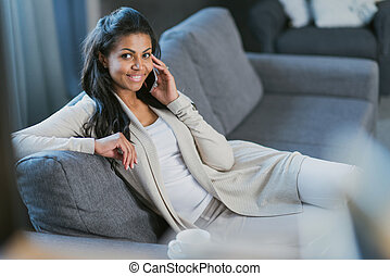 young african american woman with smartphone at home