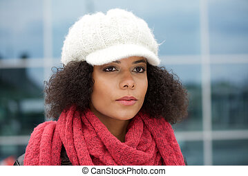 Young african american woman with winter hat and scarf